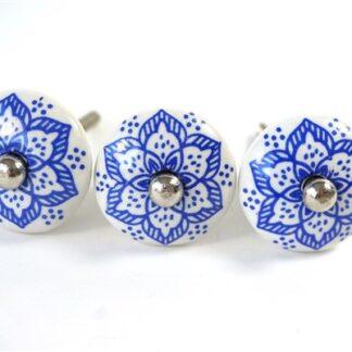 3 blauw/witte knoppen